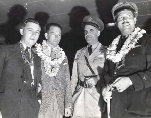 Clyde Pangborn and Roscoe Turner arrived in Hawaii on November 26, 1934 after finishing second in the London to Melbourne Air Derby. Their Boeing plane was carried on a ship to Hawaii. From left, Reeder Nichols, radio operator of the American plane; Panghorn, Capt. B. B. Cassidy, US Army, who served with Pangborn during World War I, and Turner.