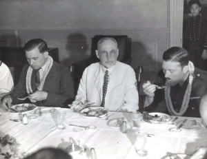 Clyde Panghorn, American flyer, Judge Walter F. Frear, former Governor of the Territory, and Roscoe Turner, American flyer, at a dinner honoring Pangborn and Turner who arrived in Hawaii on November 26, 1934 after finishing second in the London to Melbourne Air Derby. Their Boeing plane was carried on a ship to Hawaii.