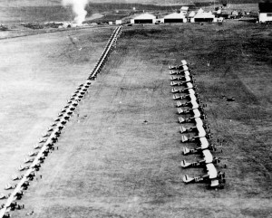Wheeler Field squadron inspection with LB-6 aircraft in front line, O-19s in the middle, and P-12 aircraft in the back, 1930s.