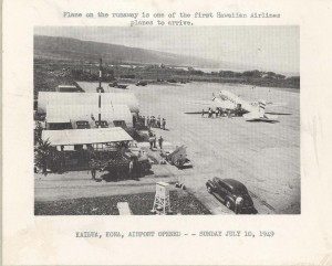 Plane on the runway is one of the first Hawaiian Airlines planes to arrive at Kailua, Kona Airport on its opening day, July 10, 1949.