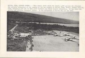 This aerial photo shows the nearly 4,000 people who attended the colorful opening ceremony of the new airport in Kailua-Kona, July 10, 1949, bringing a new era to the quiet district and famed tourist attraction. On the field are service and civilian transport planes. In the background are Kailua Bay and the town.