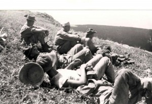 Work details on a break after climbing up the pali from a lava flow, Morse Field, Hawaii, 1940.