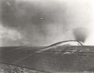 Two Japanese aircraft were photographed over Hickam Field by crew members of one of 12 B-17s that arrived from California in middle of attack. This is one of first photos of December 7, 1941 attack.