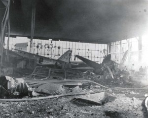 Destruction inside a hangar at Hickam Field shortly after initial raid, December 7, 1941. On left is B-18 assigned to 5th Bombardment Group.
