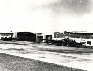 B-18 parked in front of Hangar 13 at Hickam Field with B-17 on the left near Hangar 17, December 17, 1941.