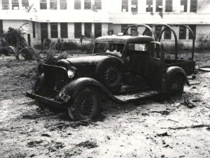 Air Corps pickup truck parked outside guard house at Hickam Field was heavily damaged, December 7, 1941. Moving vehicles were prime targets of Japanese strafers.