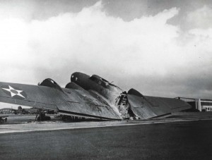 B-17C which arrived at Hickam Field from Hamilton Field, California in the middle of the December 7, 1941 attack. A strafing Zero hits its flare storage box, igniting the flares and causing aircraft to burn in two.