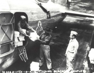 Loading blackout leaflets on B-18 at Hickam Field for distribution on Oahu, May 18, 1940.