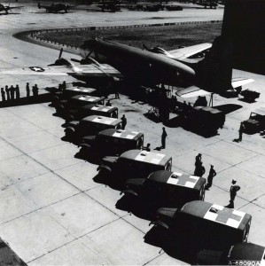 Ambulances line up near DC-54 at Hickam Field to transport patients to Tripler Army Hospital, 1942.