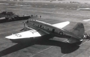 C-46 in front and C-47, C-78 and B-25 in background, Hickam Field, 1945.