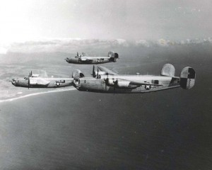 Consolidated B-24 Liberator of the 867th Bomb Squadron, 494th Bomb Corp, Hickam Field, practices formation flying off south tip of Kauai, October 1944.