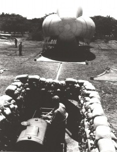 Barrage balloon and motor operated winch in sand bagged pit at Fort Kamehameha during World War II.