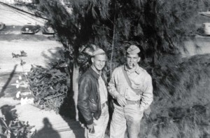 Lt. P. L. Renaison and Lt. Joe Rulley standing on steps of Officer's Building at Bellows Field, 1942.
