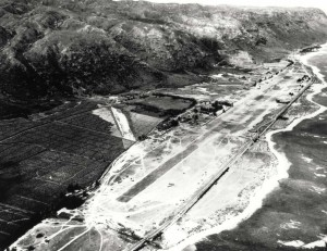 P-40s in lower foreground are decoys at Mokuleia Field, Oahu, August 1942.