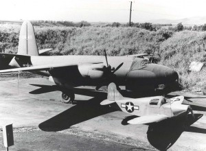 Culver PQ-8A radio controlled airplane assigned to 17th Tow Target Squadron at Wheeler Field, March 1944. It resembles a toy alongside a Martin B-26 Marauder.