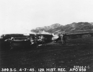 Fire fighting training using B-25 wreck at Wheeler Field, Oahu, April 7, 1945.