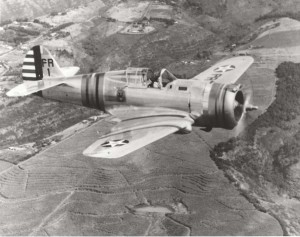 P-36A With 18th Pursuit Group emblem on fuselage, in flight over sugar cane fields on Oahu. Stationed at Wheeler Field. February 15, 1940
