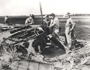 Resourceful crews remove parts from a wrecked P-40 at Wheeler Field. Of 99 P-40Bs and Cs on the island 72 were damaged or destroyed on December 7, 1941.