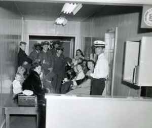 Passengers and crew await processing through U.S. Immigration Services, Honolulu International Airport, 1950s.
