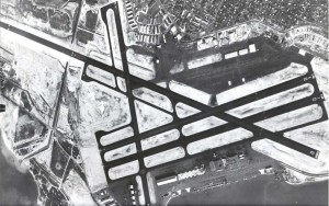 Honolulu International Airport aerial. Old Seaplane hangars can be seen in the foreground. 1950s.