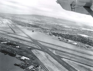 Honolulu International Airport showing the end of Runway 26 looking toward Pearl Harbor, March 6, 1958.
