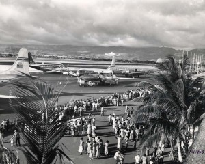 Pan American and United airways planes load passengers for departure at Honolulu International Airport, 1950s.