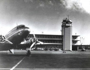 Miss Oahu on ramp at Honolulu International Airport, 1950s.