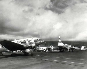 Hawaiian Airlines plane at Honolulu Airport, 1950s.