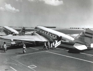 Passengers board Hawaiian Airlines plane at Honolulu International Airport, 1950s.