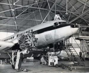 Mechanics work on a Hawaiian Airlines engine.