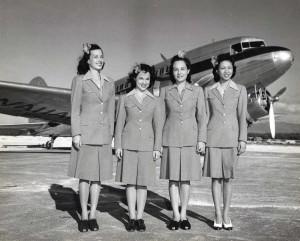 Hawaiian Airlines flight attendants at Honolulu International Airport, 1950s.