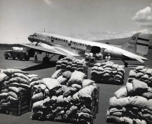 Hawaiian Airlines air cargo sits on the ramp at Honolulu International Airport, 1950s.