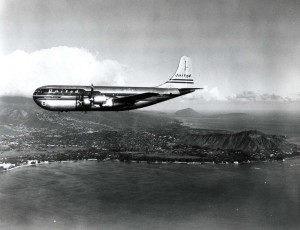 United Air Lines Mainliner cruises past Waikiki, 1950s.