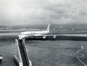United Airlines pulls into gate at Honolulu International Airport, 1950s.