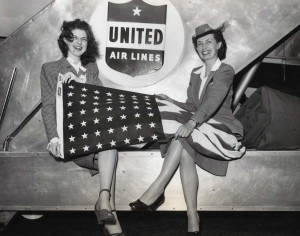 United Airlines flight attendants at Honolulu International Airport ready flight for Hawaii Statehood Commission flight to Washington, D.C., 1950s.
