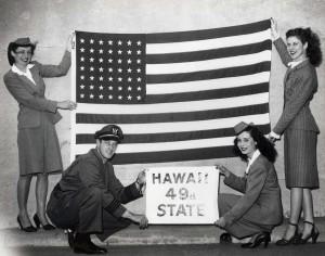 United Airlines flight attendants at Honolulu International Airport ready flight for Hawaii Statehood Commission flight to Washington, D.C., 1950s.