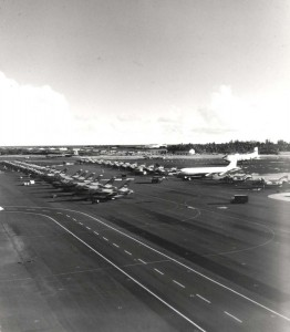 Hickam Air Force Base, Hawaii, flight line in 1960s during Vietnam War. Fort Kamehameha trees are shown at right.