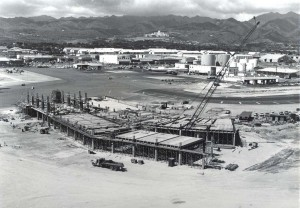 Gulf Wing Concourse at Honolulu International Airport showing completed Taxiway K Extension in background; apron and hardstands construction in foreground, 1962.