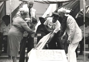 Two plaques were unveiled at Wheeler Air Force Base ceremony commemorating 50 Years of flight in Hawaii, August 19, 1977. The plaques honored the Maitland-Hegenberger and Dole Derby flights from Oakland, California to Wheeler Field. Claire Engle, Chamber of Commerce of Hawaii, congratulates Col. Charles Dolan, last living pilot of the Lafayette Escadrille; Wheeler Brig. Gen. William G. MacLaren; 1st Lt. Gene Tigne, and Hawaii DOT Director Adm (ret) Alvey Wright.