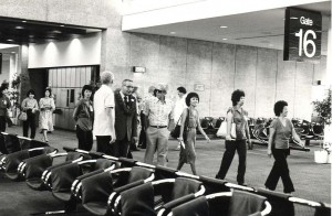 Passengers walk through the Central Concourse at Honolulu International Airport, 1980.
