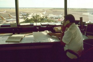 Ramp Control worker views the Central Concourse, Honolulu International Airport, 1987.