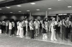 Passengers wait for security check, Honolulu International Airport, 1980.