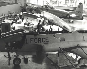 Members of the 15th Org. Maintenance Squad at Hickam Air Force Base, Hawaii, check out a recently acquired T-33 Shooting Star. The Lockheed T-33 in foreground is newer placement model, 1980s.