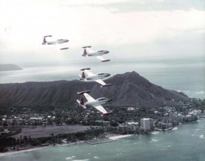 T-33A Shooting Star aircraft of the 15th Air Base Wing, Hickam Air Force Base, Hawaii, fly past Waikiki Beach, 1982.