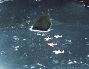 T-33A Shooting Stars from Hickam Air Force Base, Hawaii, fly in formation over Black Rock, 1982.