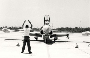 T-33A Shooting Star being guided into a parking spot at Hickam Air Force Base, Hawaii, August 2, 1985.