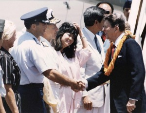 Col. Wayne E. Clark, 15th Air Base Wing Commander, welcomes President Reagan to Hickam Air Force Base, Hawaii, April 26, 1986.