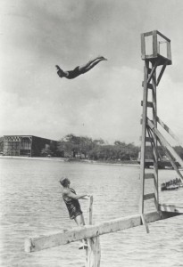 Divers enjoy the waters off of Fort Kamehameha. The seaplane hangars are in the background, 1913.