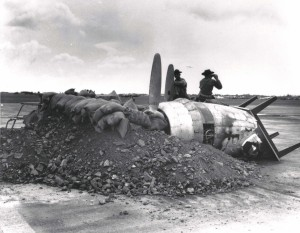 Gun emplacement in front of Hangar 5 at Hickam Field, built with a burned out aircraft engine, table, sand bags and debris, December 7, 1941.