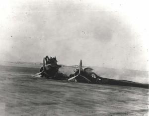 B-18 wreckage on Hickam Field flight line, December 7, 1941.